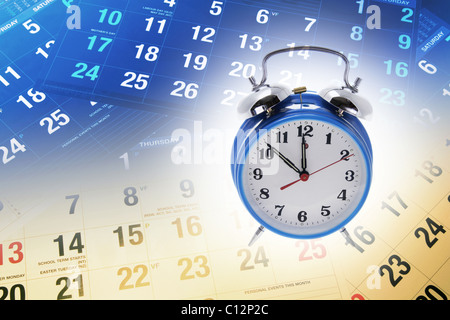 Calendar Pages and Alarm Clock - Stock Photo
