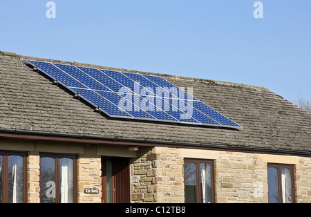 Solar panels on a modern bungalow in Yorkshire, UK - Stock Photo