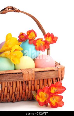 Basket full of easter eggs and spring flower - Stock Photo