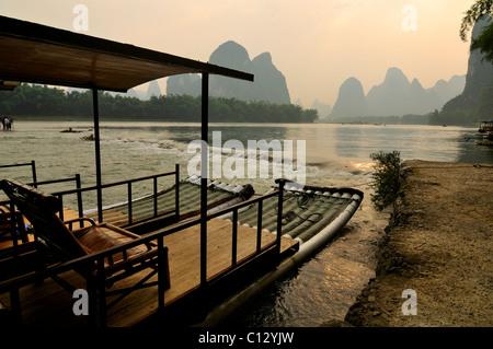 tourist boat on Li River near Yangshuo in Guilin region of China - Stock Photo
