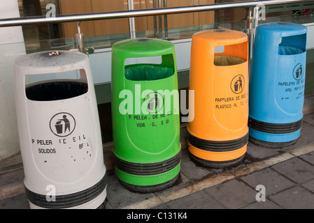 four coloured bins lined up - Stock Photo