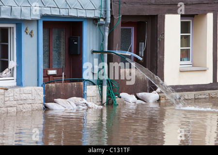 Flooded street and houses on the river Werra, caused by melting snow, Lower Saxony, Germany - Stock Photo