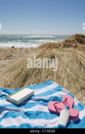 USA, Massachusetts, towel on Marram Grass on beach - Stock Photo