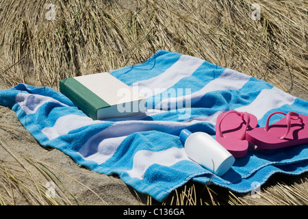 USA, Massachusetts, towel on Marram Grass - Stock Photo