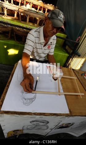 clever artist, strange people, street life , bangkok, thailand - Stock Photo
