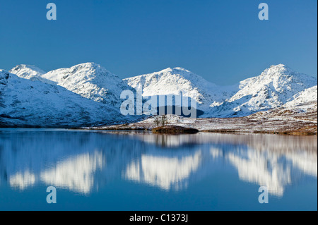 Loch Arklet, the Trossachs, Stirling, Scotland, UK. The Arrochar Alps are reflected in the loch. - Stock Photo