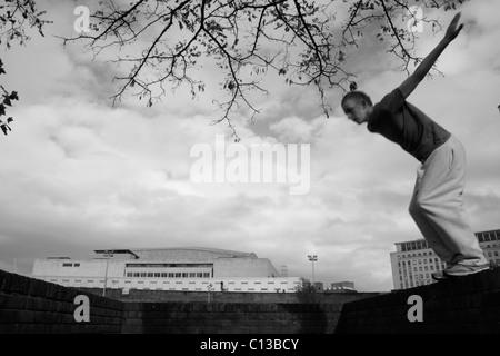Teenage boy practicing free running - Stock Photo
