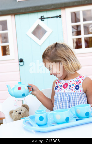 A young girl plays outdoors - Stock Photo