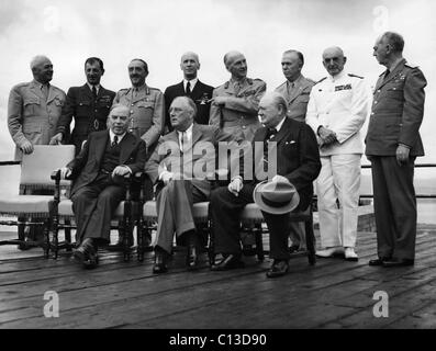 World War II. Seated, from left: W.L. Mackenzie King, Franklin Delano Roosevelt, Winston Churchill. Standing, from - Stock Photo