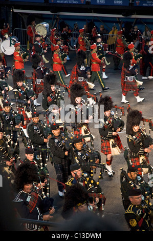 Edinburgh - Aug. 6: Massed Pipes & Drums on the grounds of Edinburgh Castle during the Royal Edinburgh Military - Stock Photo