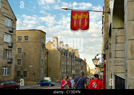 Canongate area with shoppers and view from New Street corner looking down towards the water, Edinburgh, Scotland, - Stock Photo