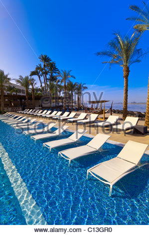 Swimming Pool At The Hilton Luxor Resort And Spa On The Nile River In Stock Photo Royalty Free