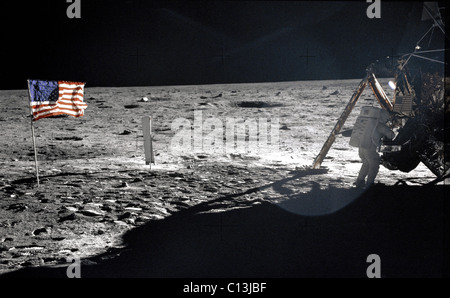 NEIL ARMSTRONG, standing on the moon, near the flag, July 1969. (c)NASA. Courtesy: Everett Collection.