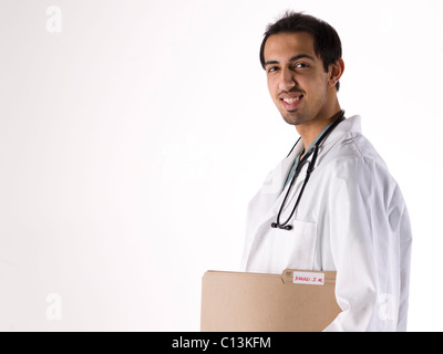 Portrait of young doctor - Stock Photo