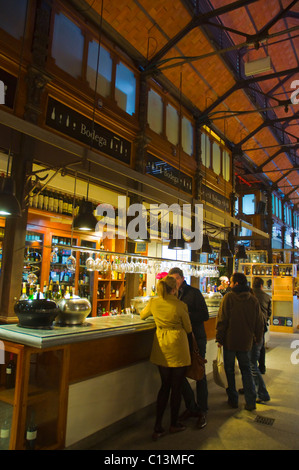 People at wine bar in Mercado de San Miguel market hall La Latina district central Madrid Spain Europe - Stock Photo