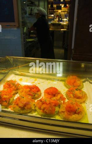 Seafood tapas in Mercado de San Miguel market hall La Latina district central Madrid Spain Europe - Stock Photo