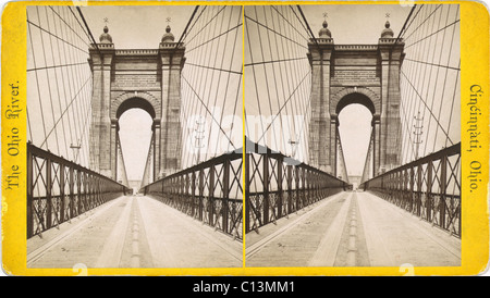 Suspension bridge spanning the Ohio River at Cincinnati was engineered and built by John A. Roebling. When it opened - Stock Photo