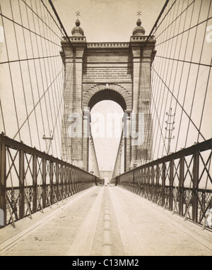 Suspension Bridge spanning the Ohio River at Cincinnati was engineered and built by John A. Roebling. Opened in - Stock Photo