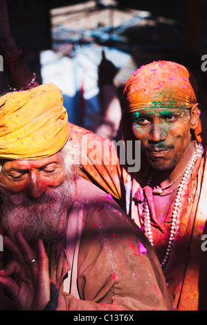 Two men celebrating Holi festival, Barsana, Uttar Pradesh, India - Stock Photo