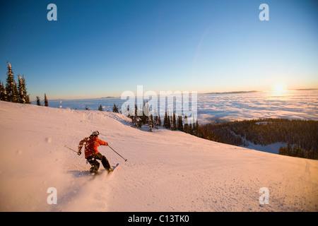 USA, Montana, Whitefish, Mid adult man skiing - Stock Photo