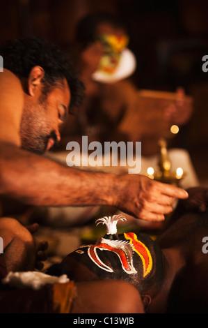 Man preparing for Kathakali performance, Kochi, Kerala, India - Stock Photo