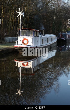 Narrowboat with wind turbine generator - Stock Photo