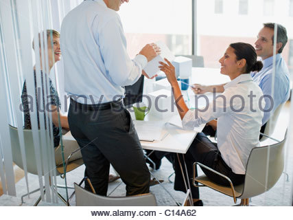 Business people looking at cubes in conference room - Stock Photo