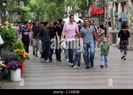 tourists infront of flower shop in la rambla street,barcelona,spain,europe - Stock Photo
