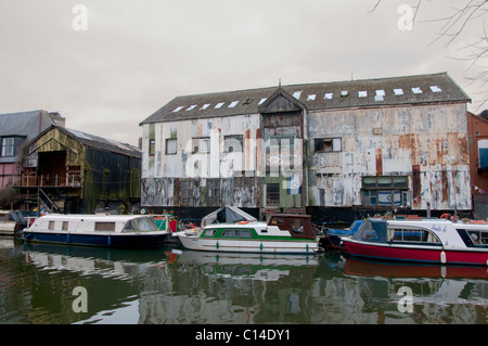 Old boats tied up on River wensum Norwich - Stock Photo