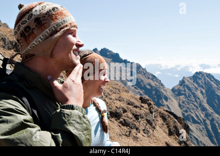 Two young people enjoy themselves on Dead Woman's Pass, Inca Trail. - Stock Photo
