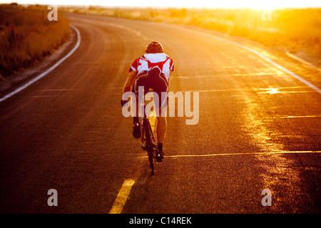 A cyclist on road bike near Great Salt Lake - Stock Photo