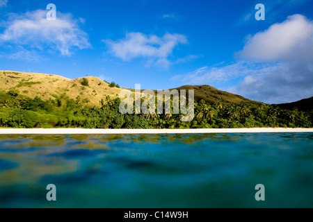 Clouds pass over the rolling hills of the island of Nacula, Fiji. - Stock Photo