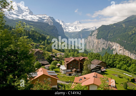 Wengen and the Lauterbrunnen valley beyond, with the peak of The Breithorn prominent in the distance - Stock Photo