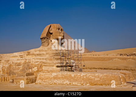The morning smoke clears to view both the Great Sphinx of Giza and the Pyramid of Khufu (Cheops) in Egypt - Stock Photo