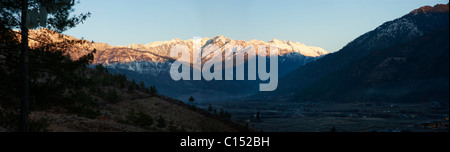 Panoramic view of the Paro Valley, Bhutan at dawn after a snow storm high in the Himalayan Mountains - Stock Photo
