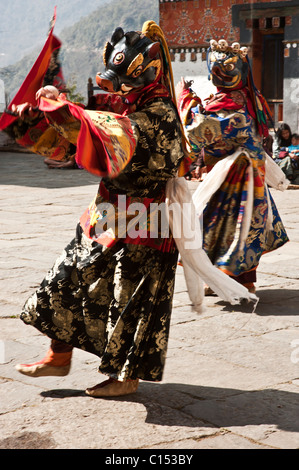 Bhutanese monks prepare to dance in a Buddhist festival in the central Bhutanese dzong of Trongsa. - Stock Photo