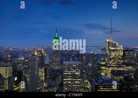 Manhattan at night showing Empire State Building - Stock Photo