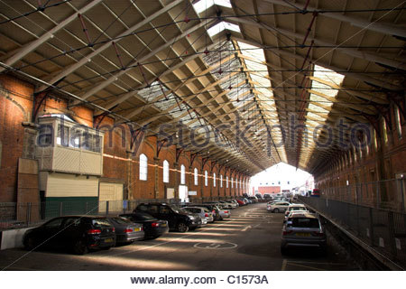 Inside the original Temple Meads railway station, the extended train shed section with the old signal box visible, - Stock Photo