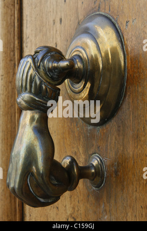 Ornate brass door knocker on an old house in France - Stock Photo