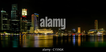 Singapore City Skyline by the River at Night Panorama - Stock Photo