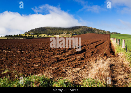 A freshly plowed field at Warrenheip which is located near the regional city of Ballarat in Victoria Australia. - Stock Photo