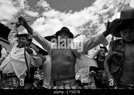 Indians, wearing white shirts, dance furiously during the Inti Raymi (San Juan) festivities in Cotacachi, Ecuador. - Stock Photo