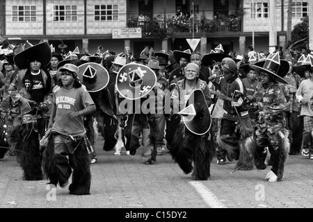 Indians dance furiously during the Inti Raymi (San Juan) festivities in Cotacachi, Ecuador. - Stock Photo