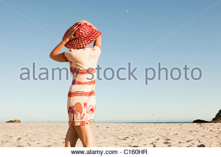 Woman wearing red hat on vacation - Stock Photo