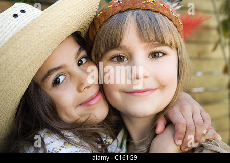 Girls dressed as Native American and cowgirl - Stock Photo