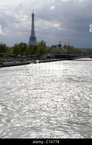 Eiffel Tower in a stormy atmosphere on the Seine River, Paris, city center, France, Europe - Stock Photo
