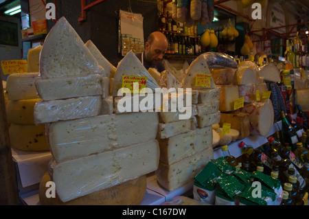 Cheesemonger at street market in Catania Sicily Italy Europe - Stock Photo