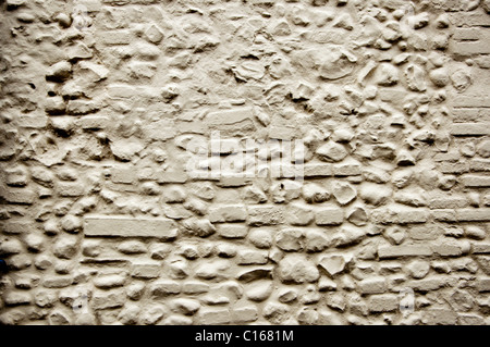Detail of wall and Brick work with flint painted white - Stock Photo