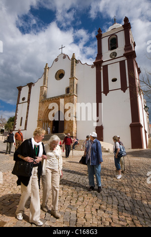 Tourists at Sé Cathedral of Silves in the Algarve, Portugal - Stock Photo
