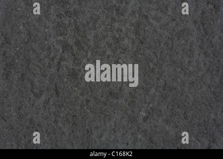 Rough textured background in dark gray stone - Stock Photo